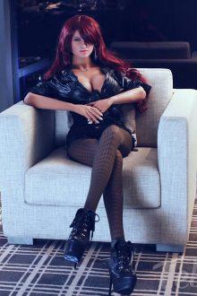 Redhead sex doll Dorothy sitting