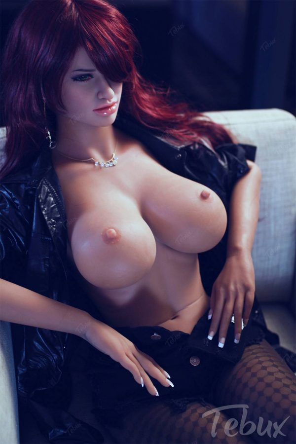 Redhead sex doll Dorothy sitting topless