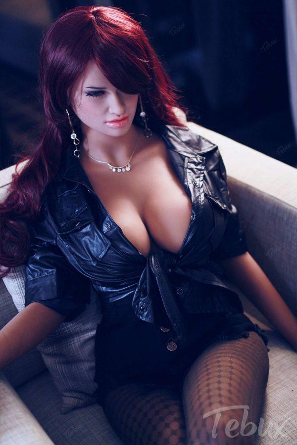 Redhead sex doll Dorothy sitting in black tights