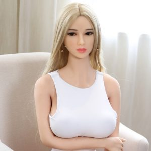 Sex doll big tits sitting on chair