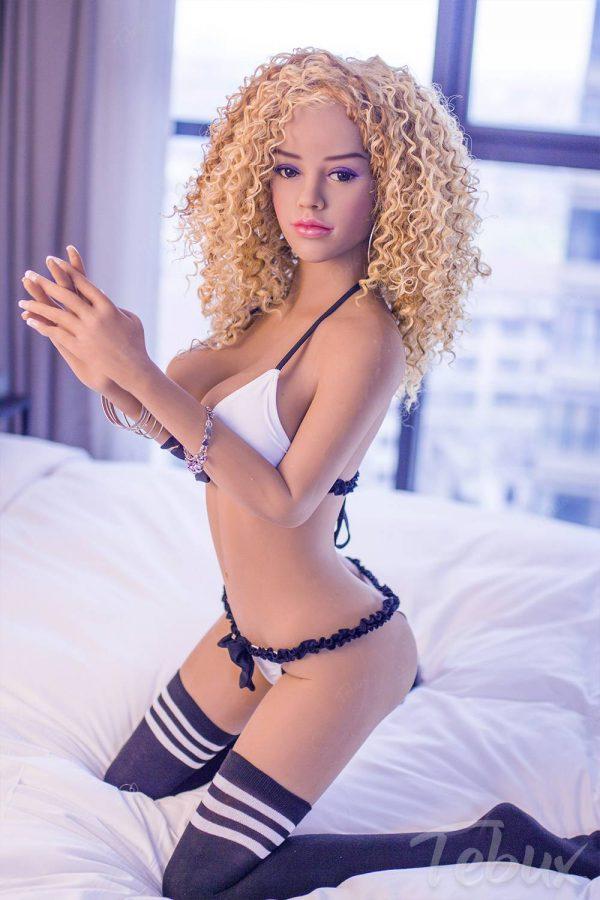 Small sex doll sitting wearing lingerie