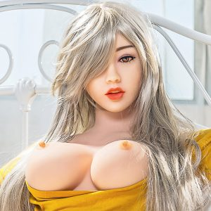 Small silicone sex doll sitting down topless