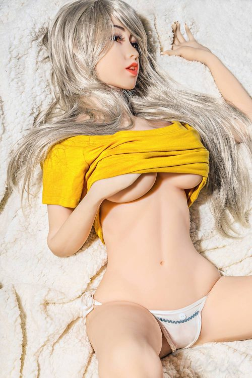 Small silicone sex doll lying down