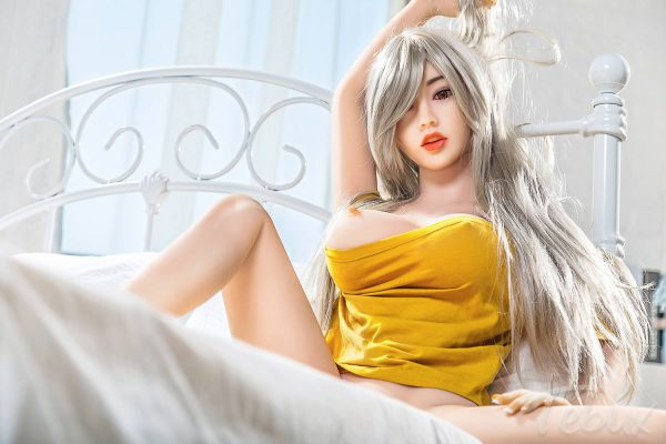 Small silicone sex doll lying down naked