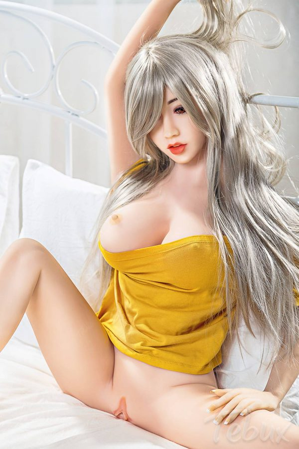 Small silicone sex doll sitting down naked
