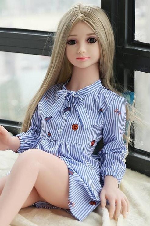 blonde Mini Sex Dolls in pyjama smiling at the camera