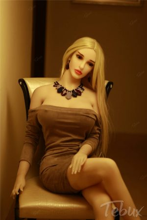 Blonde mature sex doll in brown dress with necklace