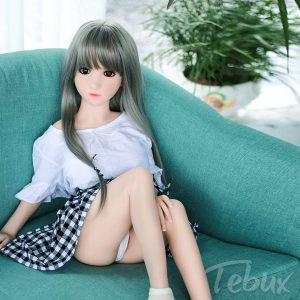 Teen love doll sitting on couch