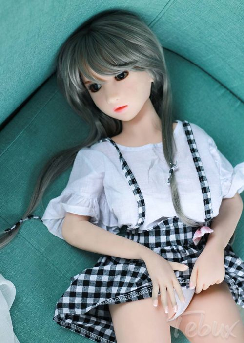 Teen love doll lying down