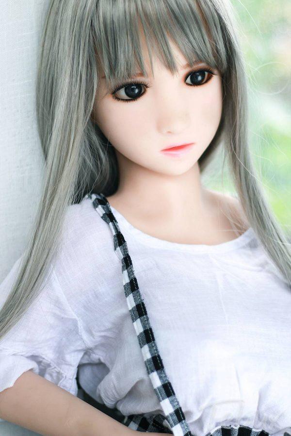 Teen love doll sitting