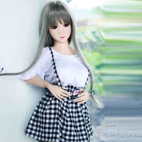 Teen love doll standing in dress