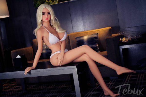 Teen love doll Juliete sitting wearing bikini