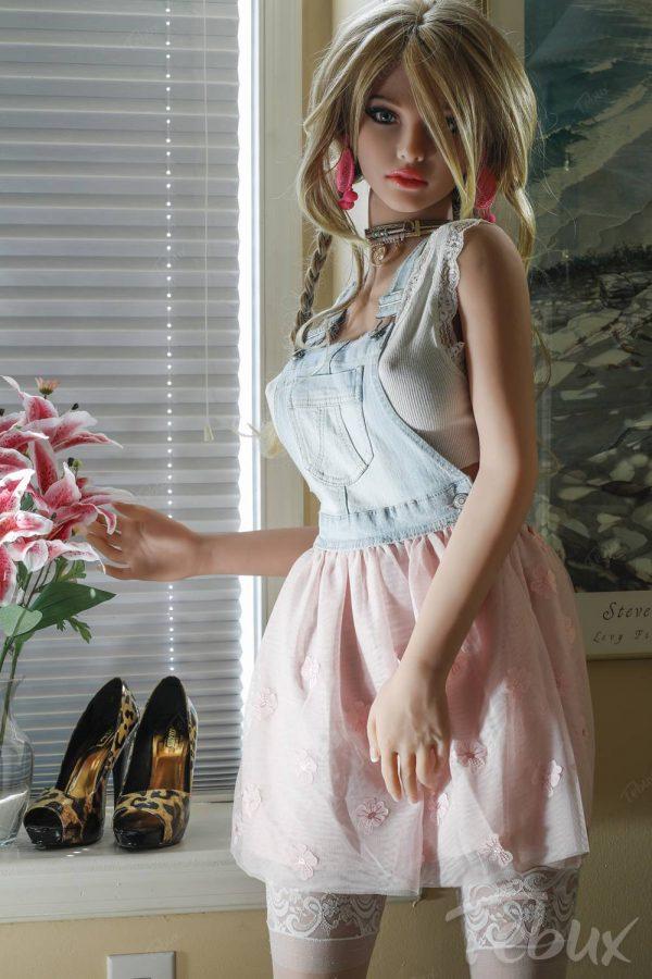 Teen sex doll Noa standing