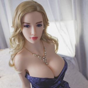 TPE dolls like Galilea sitting wearing blue dress