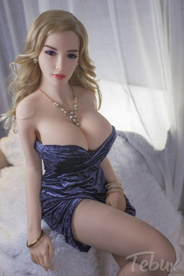 TPE dolls like Galilea sitting wearing blue dress