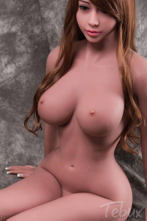 Tpe sex dol sitting naked
