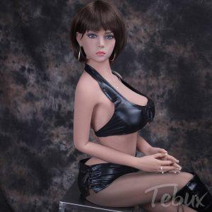 Ultra realistic sex doll Lilian sitting wearing leather lingerie