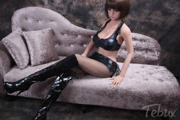 Ultra realistic sex doll Lilian sitting wearing leather lingerie