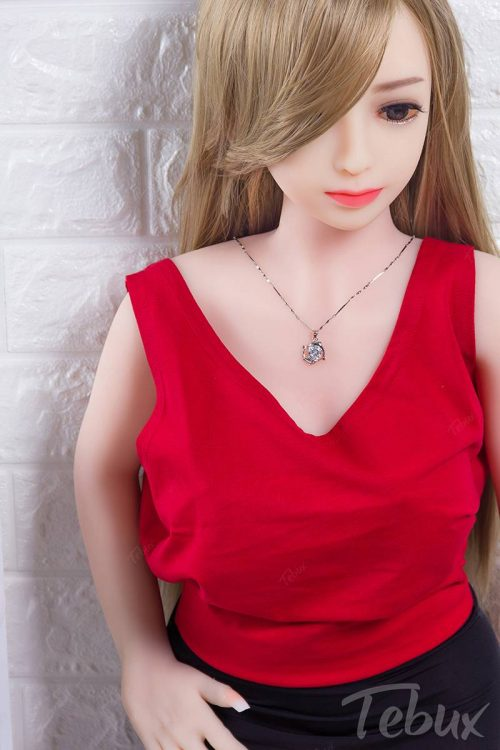 Young love doll Addison standing in red top