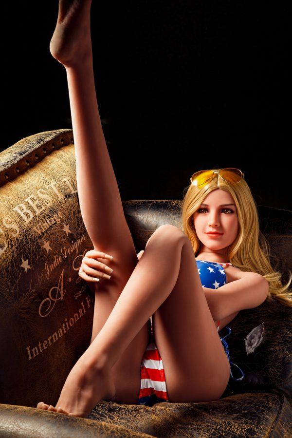 Blonde curvy sex doll with American bikini.