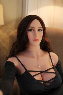 Curvy Sex Dolls brunette showing cleavage through black shirt