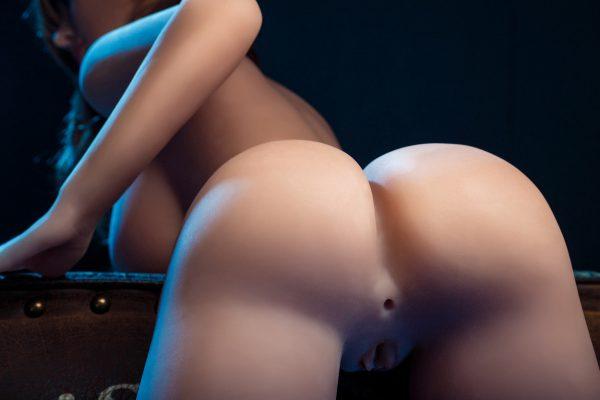 Life-like sex doll Mary bending over naked